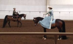 Kate Halle riding side saddle in a competition